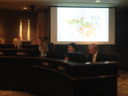 Jeff Plyman (second from right), general counsel for Joliet, explains why the city council needs to adopt a new map now to comply with federal law.