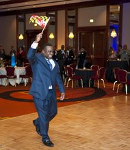 NAREB president Donnell Spivey heads to the podium for his greeting and remarks proudly waving the  Maryland state flag.