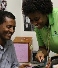 Obamacare navigator Jekisha Elliot helps Geremen Teklehaimanot sign up for health insurance in Baltimore