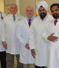 Experts in Family Medicine, Infectious Diseases, Podiatric Medicine and Vascular Surgery are part of the multidisciplinary approach to treating patients at the University of Maryland Medical Center Midtown Campus Wound Healing Center. (Left to right) Dr. Dan Howard; Dr. William Anthony; Brian Belgin DPM; Dr. Daljeet Saluja; and Dr. Kapil Gopal.