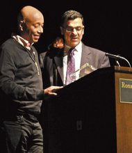 """Salam Al-Marayati, president and a founder of the Muslim Public Affairs Council, (MPAC), right honored philanthropist and Hip Hop mogul Russell Simmons Saturday at USC as a """"Voice of Courage and Conscience"""" for using his celebrity status to promote acceptance and understanding in the face of bigotry toward Islam and Muslims, and for his consistent efforts to promote the voices and talents of Muslim artists on mainstream outlets. """"Russell Simmons is a powerful figure on the interfaith scene, who continues to inspire many to action and empowers youth to come together in love and acceptance,"""" said Al-Marayati./OW photo by Mesiyah McGinnis."""