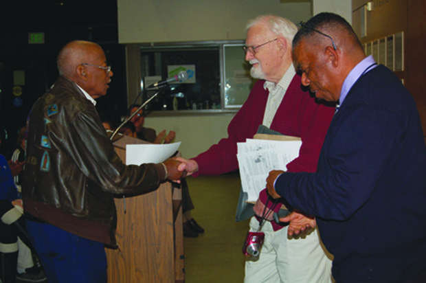 Former Tuskegee airman Alexander Jefferson, 92, (left) and longtime Portland educator Bob Gerber, 91, shake hands while reminiscing on their World War II service during a veterans forum at Portland Community College in north Portland. Gerber said his own life was saved by Jefferson and three other members of the all-black Tuskegee squadron after his plane was attacked by German troops. Gerber shed tears recounting the experience, saying the heroism by the black fighter pilots forever transformed his views on race.