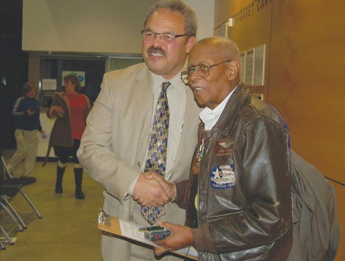 """Alexander Jefferson, 92 (right), a member of the historic Tuskegee Airmen joins State Rep. Lew Frederick during a Veterans forum at Portland Community College's Cascade Campus. Jefferson recounted several moments of racism and countless war deaths during his tenure of service in World War II, but the Detroit-native still heralds the United States of America as """"the greatest country in the world."""""""