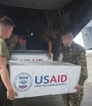 Marines and U.S. Army Soldiers load supplies onto an MV-22 Osprey assigned to the Marine Medium Tiltrotor Squadron 261, 1st Marine Aircraft Wing, in support of Operation Damayan. The George Washington Strike Group supports the 3rd Marine Expeditionary Brigade to assist the Philippine government in response to the aftermath of Super Typhoon Haiyan/Yolanda in the Republic of the Philippines.