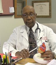 Dr. Elijah Saunders, a cardiologist who served as professor of medicine and head of the section of hypertension at the University of Maryland School of Medicine, died early Tuesday. He was a pioneer in research related to African Americans and hypertension. (Above) Dr. Saunders explains how diabetes impacts coronary arteries, which can cause a heart attack.