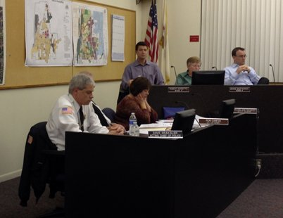 More than 50 people showed up at Wednesday's Lockport City Council meeting to support Acting Chief Dave Draksler (left).