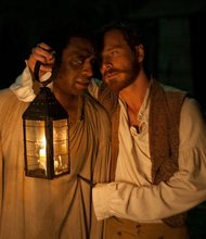 "Chiwetel Ejiofor, left, stars as Solomon Northup and Michael Fassbender stars as Edwin Epps in ""12 Years a Slave."""