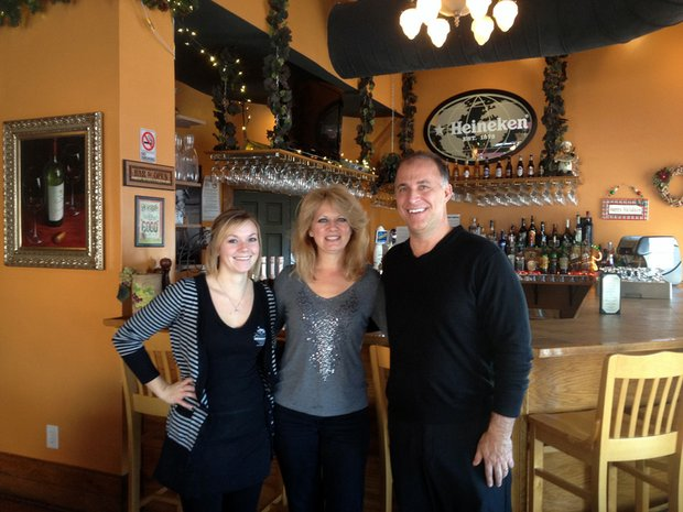 Frank Degrassi (right) is owner of Mama Onesta's at 1100 S. State St., in downtown Lockport. He is pictured with server Sara Bonko (left) and his wife, Mary.