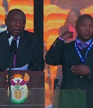 To those outside the deaf community, the sign language interpreter for Nelson Mandela's memorial may have looked like he was working very hard, translating the spoken words into gestures for four hours. But he was a complete fake, and his actions outraged deaf people around the world, according to an association for the deaf community in South Africa.