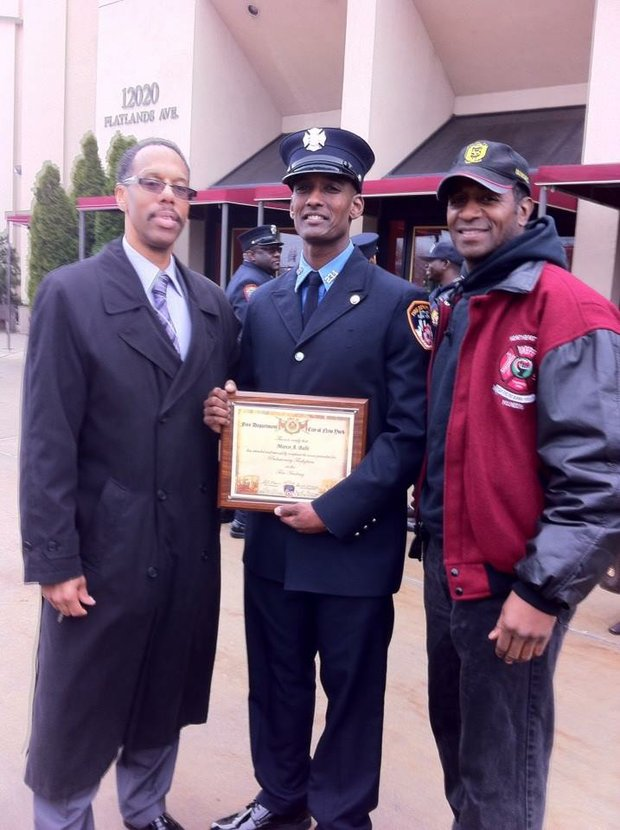 Captain Paul Washington, new FDNY recruit Marco Babi and Vulcan President John Coombs