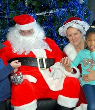 Alex Reeve, age three and Shelby Oliver, age four with Santa and Mrs. Claus.