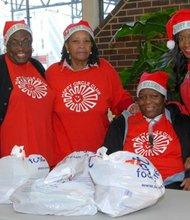 Members of the Happy Circle Club (Left to right) Brenda Cousar; Catherine Hartfield; Daphne Green; Ayana Jackson, Service Coordinator, Resident Services; and Myra Johnson (not shown in photo).