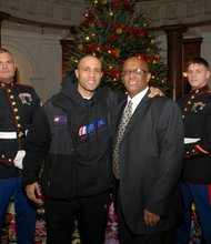 "United States Marine Russell Csigay; Choo Smith of the Harlem Globetrotters; City Council President Bernard ""Jack"" Young; and United States Marine, Galen Theus at the Toys for Tots event at Baltimore's City Hall."