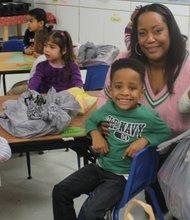St. Jerome Head Start students Tristin and Kelli with Epsilon Omega member Shaletta Espie