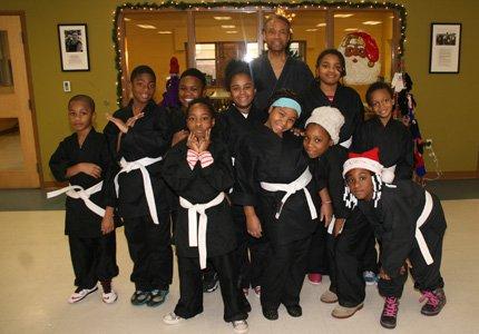 Baltimore Attorney and Baltimore City Orphans' Court Judge Lewyn Scott Garrett awards karate uniforms to kids at John Eager Howard ...