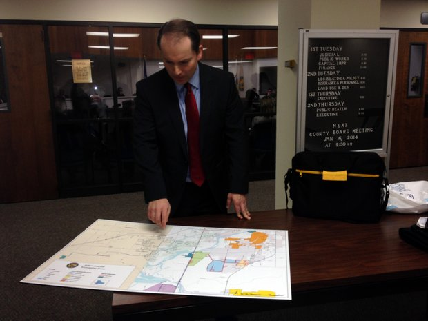Dave Stryker looks over a map showing the proposed expansion of the Joliet Arsenal Enterprise Zone.