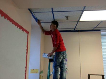 Ivan Barrera, of Joliet, paints one of the rooms at the Spanish Community Center in Joliet.