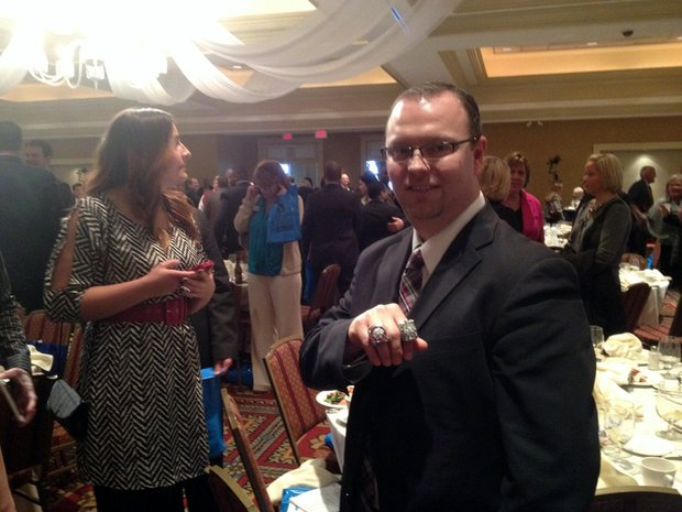Tony Ommen, senior director of team services for the Chicago Blackhawks, brought the championship rings to the mayor's State of the Village luncheon.