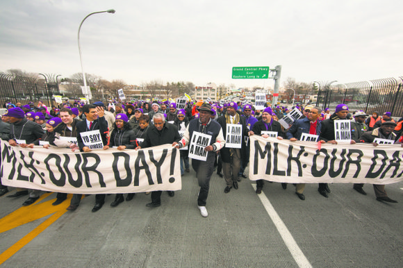 New York City area airport workers continued their fight for better wages last Friday while honoring a civil rights legend.