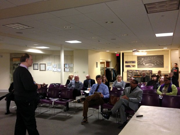 David Burr, a planning consultant with Rich & Associates, discusses downtown parking problems with Joliet business leaders and Will County officials at a meeting held Thursday at the Joliet Historical Museum.