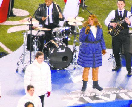 Queen Latifah singing at Super Bowl XLVIII