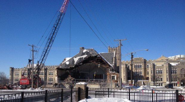 The Little Theater building on the campus of Joliet Central High School was demolished Friday.