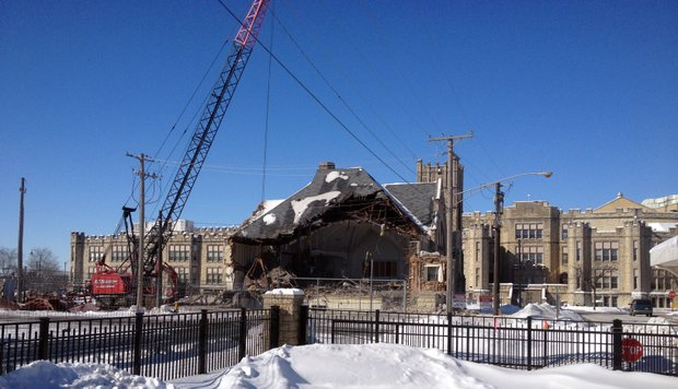 Crews had removed about half of the Little Theatre at Joliet Central High School by 11 a.m. Friday.