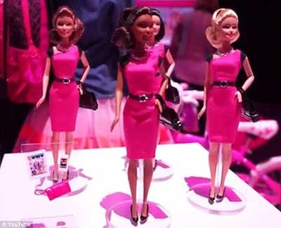 Toymaker Mattel wants little girls to have the entrepreneurial spirit with its new Barbie. Wearing a pink dress with conservative ...