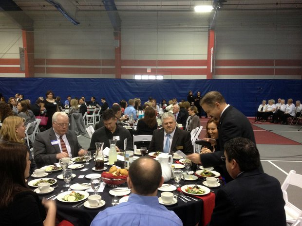Romeoville Mayor John Noak (standing) prepares to give his State of the Village speech Thursday at Lewis University.