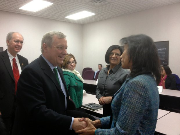Sen. Dick Durbin (D-Ill.) shakes hands with Elisabeth Navarez at the Joliet Region Chamber of Commerce & Industry Tuesday. Durbin and U.S. Rep. Bill Foster (standing behind the senator) met with Hispanic business leaders to discuss immigration reform and other issues.