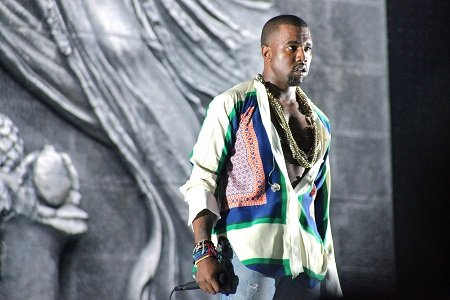 Kanye West is paying a price for not ignoring a swarm of paparazzi surrounding him at an airport this past ...