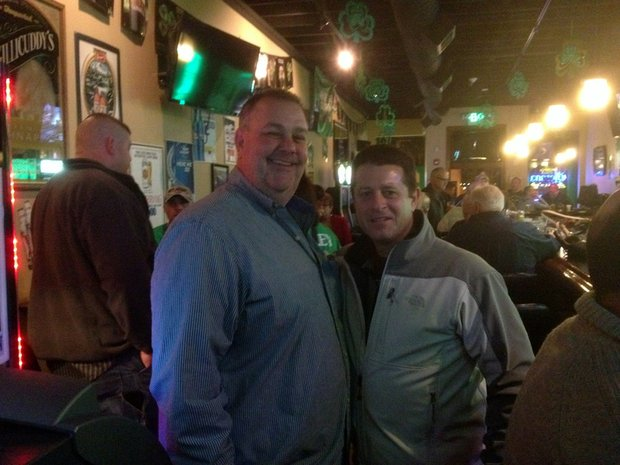 Mike Kelley (left) is all smiles Tuesday night after winning the Democratic Primary Election for Will County Sheriff. He is pictured with Will County Coroner Pat O'Neil, at Jackie's Pub in Lockport.