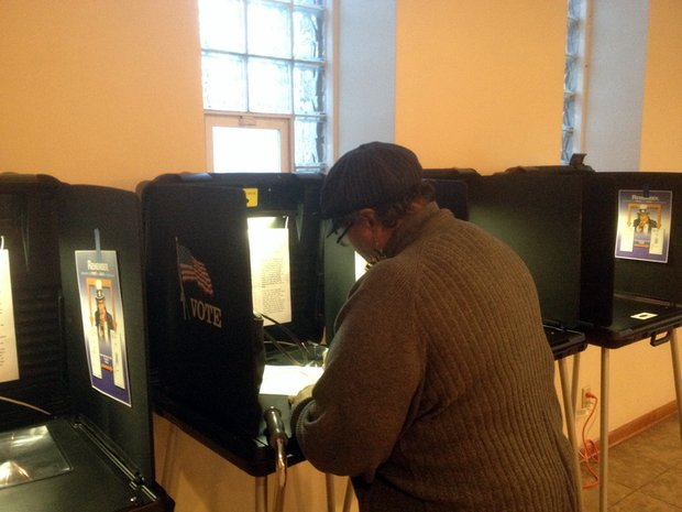Linda Weatherspoon, of Joliet, was one of the last to cast a ballot in Tuesday's election at Christ Temple Church at 212 Richards Street.