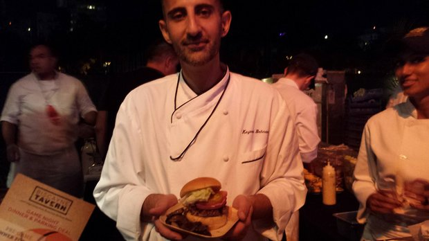 Ready to eat: A chef displays his burger creation.