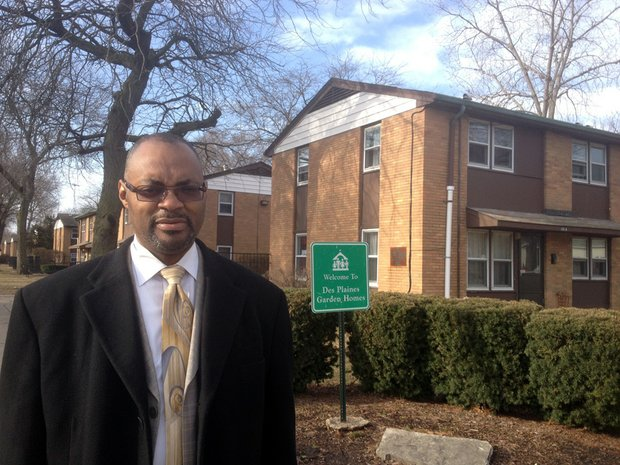 Joliet City Councilman Terry Morris, 5th District, stands outside the Des Plaines Garden Homes low income housing development. The development is in Morris' district. The Housing Authority of Joliet is considering demolishing the development to make way for single family homes and townhouses.