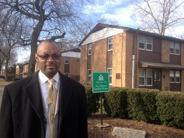 Joliet City Councilman Terry Morris (District 5) stands outside Des Plaines Garden Homes. The low-income housing development is in his district and the Housing Authority of Joliet has plans to demolish the complex and build a mix of single-family and multi-family homes.