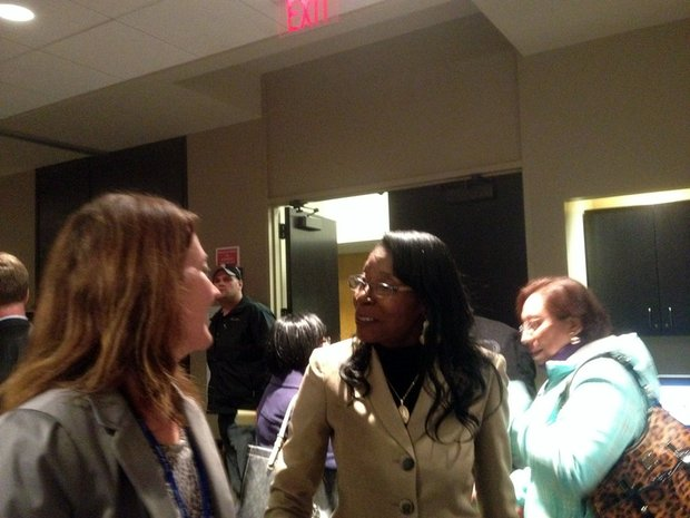 Joliet City Clerk Christa Desiderio (left) chats with new 4th District City Councilwoman Bettye Gavin after Tuesday's council meeting.