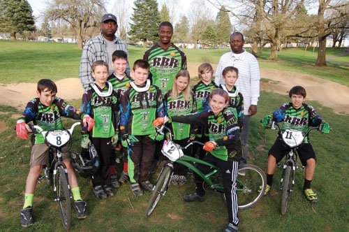 Brothers Harold and Kevin Ridge and members of their 32-person all-ages team of BMX racers from the Portland area. As they continue to see success with their current team, they are looking to start up an offshoot for inner-city youth and kids of color called Kidz on Da Track.
