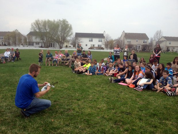 Jim Tieber, a certified arborist for Joliet, shows students how to plant a tree.