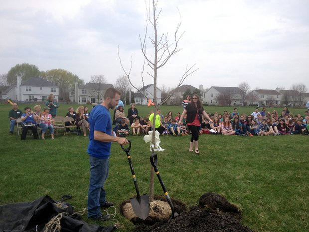 Jim Tieber, arborist for Joliet, gets the shovels ready for the students to help plant the tree.