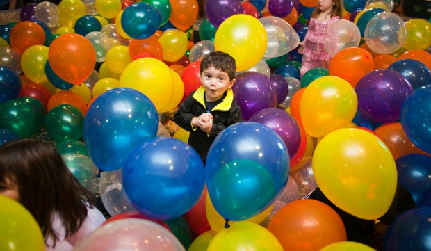 Alexander Rios, 2, of Joliet, plays in the balloon pit Saturday during the 10th annual Hippity-Hop Easter Egg Hunt  at The Timbers of Shorewood.