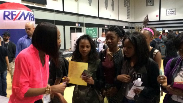 Shakila Stewart, model, actress, dancer, director and CEO of Dreamah Studios in Chicago, talks show business with seventh-graders (from left) Mikahla Dell, Joann Asare and Adjoa Busia.