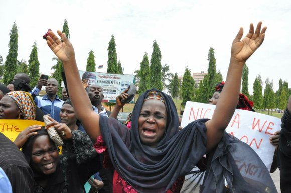 Parents demand increased government action to find schoolgirls kidnapped two weeks ago by the extremist group Boko Haram.