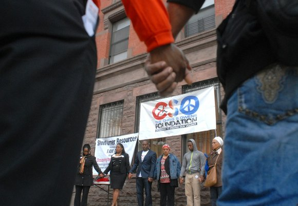 A determined collection of anti-gun violence activists, parents, concerned residents and some law enforcement officers gathered on Harlem's Lennox Avenue ...