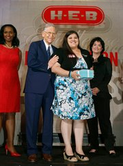 Rising Star Elementary category winner Celena Miller of Cesar Chavez Elementary School in Pharr, Texas with HEB chairman and CEO Charles Butt at the HEB Excellence in Education Awards at the Grand Sonesta Hotel in Houston, Texas Saturday May 3, 2014.