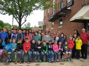 Plainfield Mayor Mike Collins, members of the Plainfield Village Board and Plainfield Historic Preservation Commission, and Central Elementary School third-graders celebrated Plainfield's Downtown National Register District Wednesday by unveiling the new National Register sign.