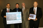 Dan Vera, Joliet Regional Port District chairman (from left), Chris Lawson, director of aviation, Dave Silverman, Joliet Regional Port District Board member, and Ron Kevish, Joliet Regional Port District Board member, pose with honors awarded to Romeoville's Lewis University Airport, which was named the 2014 Illinois Reliever Airport of the Year by the Illinois Department of Transportation's Division of Aeronautics.