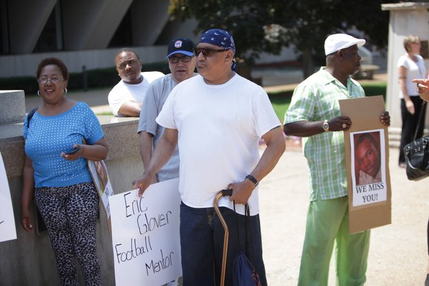 Dozens of people gathered outside the Will County Courthouse Thursday to protest the 10-year prison sentence given to Alisa Massaro, who was given a plea deal in exchange for promising to testify against her friends in the murders of Eric Glover and Terrance Rankins.