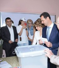 Bashar al Assad and his wife voting in Damascus 6/3/14.