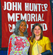 Sharon Cohen receiving the John Hunter Community Service Award from the John Hunter's Lolita Lowe.